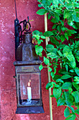 Lamp with burning candle at the wall of a house, Drome, France, Europe