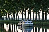 Woman ob houseboat, Canal du Midi, France