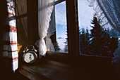 Alarm clock on a window ledge, Alpine hut, Tyrol, Austria