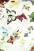 View on the several colorful butterflies made of paper from below