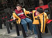 Sitting boys, tired children, Shanghai, China
