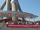 People with banner in front of pearltower, Shanghai, China