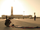 Man with kite cowering on Tiananmen Square, Peking, China, Asia