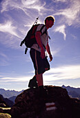 Hiker at the top of Kozi Wierch, Part of The Eagl High Tatras, Poland