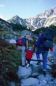 Hikers with child in Roztoka Valley, High Tatras, Poland