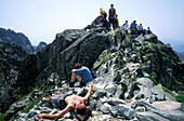 Exhausted Hikers at the top of Granaty Peak, High Tatras, Poland