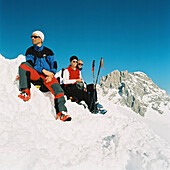 Skitouring, Skitouring, Three people sitting on a mountain peak, St. Antoenien, Graubuenden, Switzerland, St. Antoenien, Graubuenden, Switzerland