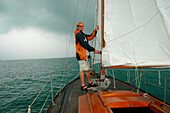 Sailing, Young man on sailing boat, Lake of Constance, Bavaria
