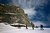 Four people on a skitour, skiing, St. Antoenien, Grisons, Switzerland