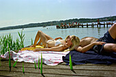 Bathing People, Young heterosexual couple lying in the sun, Starnberger See, Bavaria