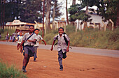 Pupils running along the street, Lebombo Mountains, Swaziland, South Africa, Africa