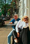 Two people at sidewalk café, Hamburg, Germany