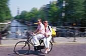 Couple on the move, Prinsengracht, Amsterdam Netherland