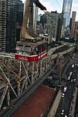 View at Roosevelt Island Tram above streets of Manhattan, New York, USA, America