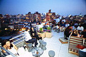People at roof deck of Gansvoort Hotel, Meatpacking District, Manhattan, New York, USA, America
