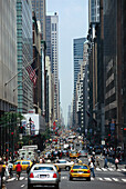 Cars and people on Madison Avenue, Manhattan, New York, USA, America