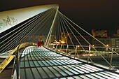 Footbridge Zubizuri in the evening, Bilbao, Basque Country, Spain
