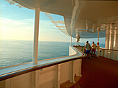 Group of people on the promenade deck, Queen Mary 2, Cruise Ship