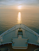 Golden light reflecting on the sea, Queen Mary 2, Cruise Ship