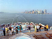 Queen Mary 2 put out from Manhattan, NYC, people on quarterdeck, Queen Mary 2