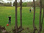 Boys playing on meadow, Eifel, Germany