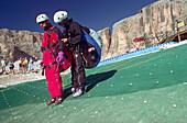 In preparation for tandem leap, near Corvara, Dolomites, Alta Badia South Tyrol. Italy