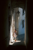 Young woman at a shadowy alleyway, Amalfi, Campania , Italy, Europe