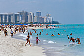 People strolling on the beach and bathing in the sea, South Beach, Miami Beach, Florida, USA, America