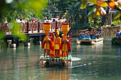 People wearing traditional polynesian costumes in boats, Polynesian Cultural Center, Laie, Oahu, Hawaii, USA, America