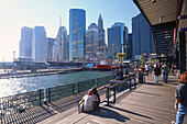 People at the harbour and view at the skyline and Hudson River, South Street Seaport, Manhattan, New York City, USA, America