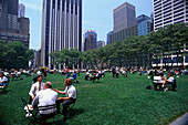 People on a meadow at Bryant Park, 6th Avenue, Theater District, Manhattan, New York, USA, America