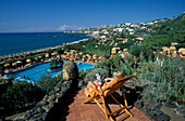 Woman on a deck chair and pool in the sunlight, Therm Garden of Poseidon, Ischia, Campania, Italy, Europe