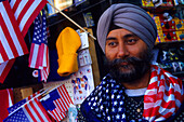 Indian salesman selling souvenirs, Manhattan, New York City, New York, USA