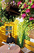 Relaxing at a garden cafe, Kochel am See Bavaria, Germany