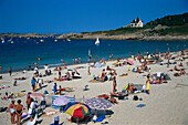 People on the beach in the sunlight, Tregastel Plage, Brittany, France, Europe