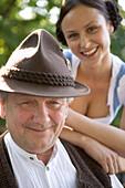 Older Bavarian man and young woman , Munich, Bavaria