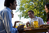 Group of young people in beer garden, Munich, Bavaria
