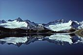 Mountain reflection in a mountain lake, Zillertal Alps, Tirol, Austria