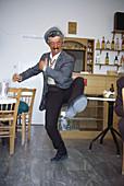 Dancing Greek in a bar in Pygros, Santorin, Cyclades, Greece