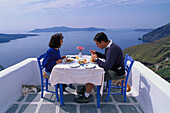 Lunch on a patio at Thira, Santorin Greece