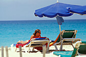 Woman lying on sunlounger on the beach, Santa Maria, Sal, Cape Verde Islands, Africa