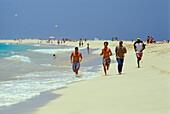 Young men running along the beach, Santa Maria, Sal, Cape Verde Islands, Africa
