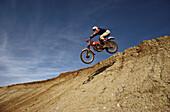 Motocross, motorcyclist during a jump