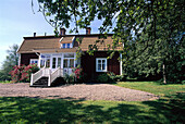 Swedish timber house in the sunlight, house where Astrid Lindgren was born, Naes, Smaland, Sweden, Europe