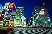 Department stores with neon signs in the evening, Shinjuku Dori Avenue, Shinjuku, Tokyo, Japan, Asia