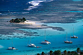 Aerial view of sailing boats off an uninhabited island, St. Vincent, Grenadines, Caribbean, America