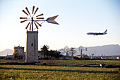 Windmills and an airplane in front of the blue sky, Majorca, Balearic Islands, Spain