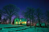 Residential house with illuminated windows on a winter's evening, Kinna, Vaester Goetland, Sweden, Europe