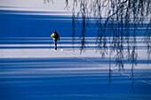 Cross country skiing, ski tracks on frozen lake, Vastergotland, Sweden