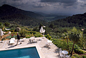 Pool of the Hotel Posada del Maques with view at scenery and thunder clouds, Majorca, Spain